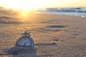 Sand Angel - Clock on a beach
